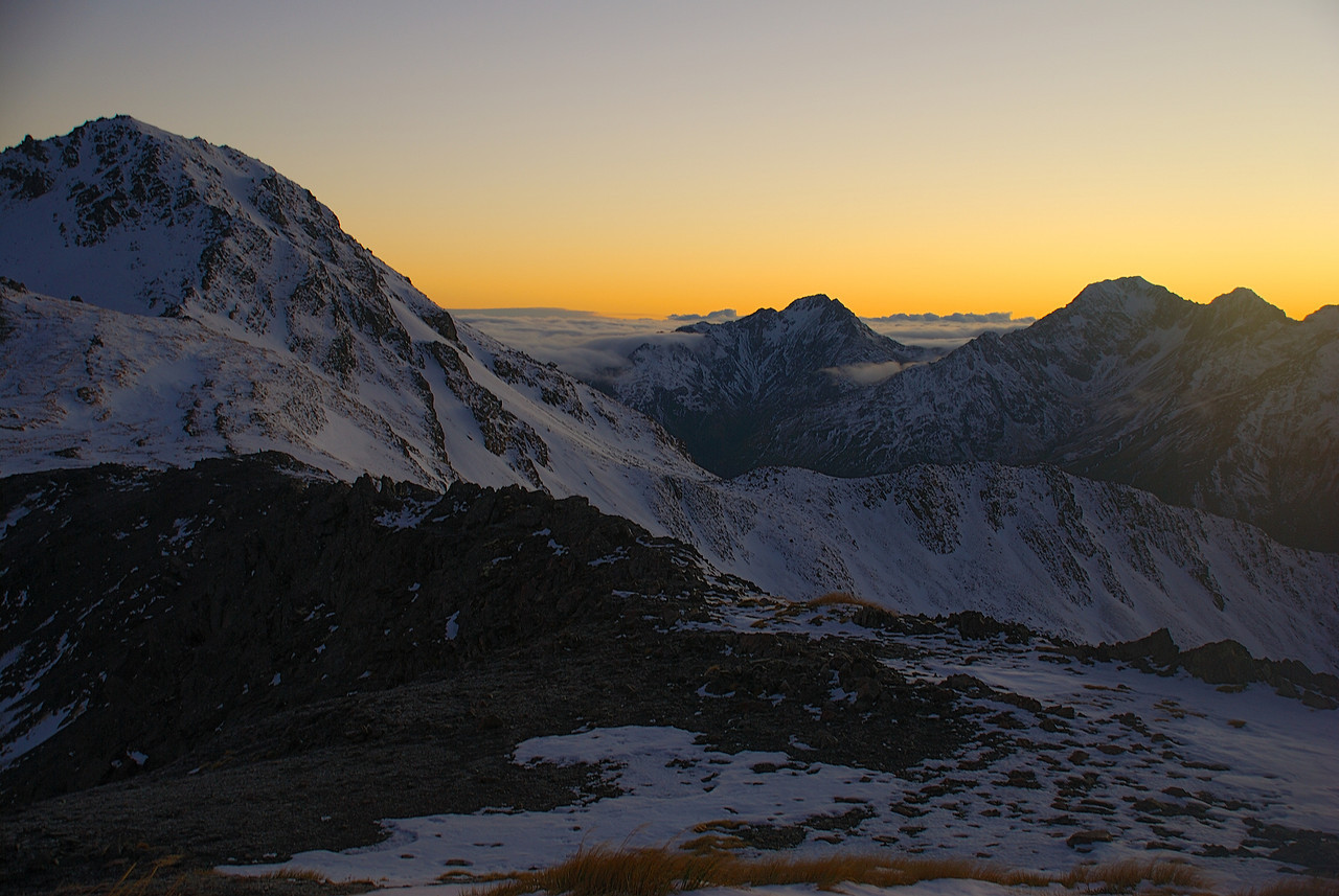 Dawn on the ridge between Lyell Peak and Avalanche Peak. From left to right are Avalanche Peak, Mt Stuart, Phipps Peak, Mt Temple