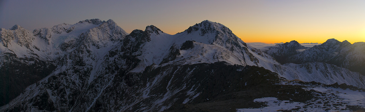 Dawn on the ridge between Lyell Peak and Avalanche Peak. From left to right are Mt Lancelot, Mt Rolleston, Avalanche Peak, Mt Stuart, Phipps Peak, Mt Temple