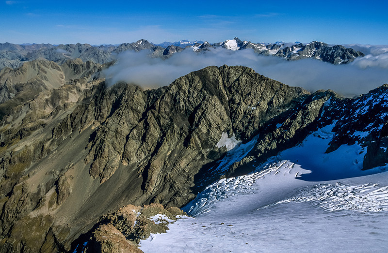 Looking south-west from the Low Peak of Mount Rolleston. Mt Lancelot is at centre image; Mt Murchison right above, on the skyline