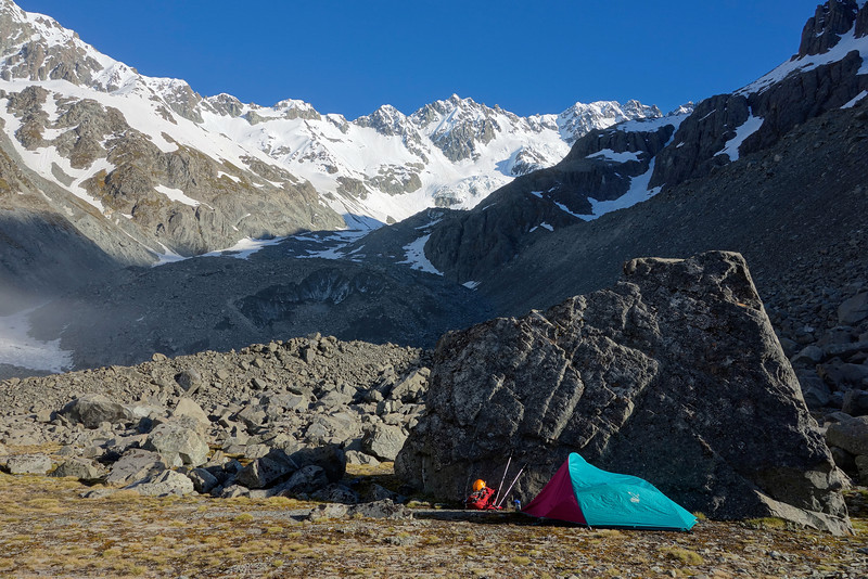 Campsite at the toe of the Ashburton Glacier. The south face of Mt Arrowsmith above