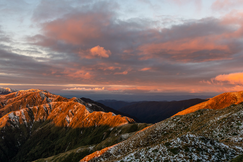 Sunset on the north ridge of Bridge Peak, Tararua Range. From left to right are Maungahuka and Vosseler.