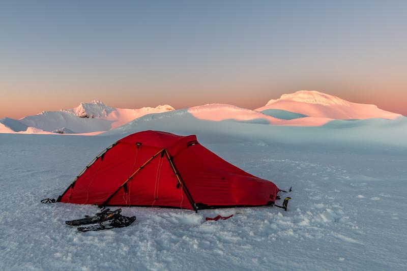 Campsite on Mount Ruapehu's Summit Plateau. Tahurangi and Paretetaitonga are in the background; Glacier Dome at centre image.