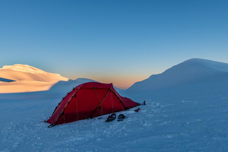 Campsite on Mount Ruapehu's Summit Plateau, under Paretetaitonga and Glacier Knob. Spot Taranaki at centre image.