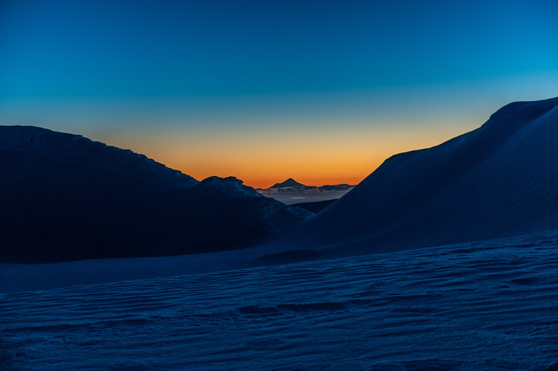 Taranaki at dusk from camp on Mount Ruapehu's Summit Plateau.