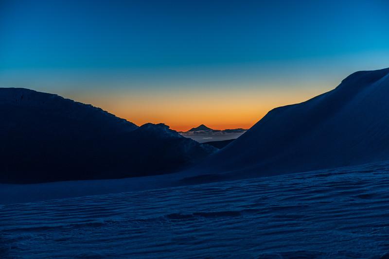 Taranaki at dusk from camp on Mount Ruapehu's Summit Plateau.