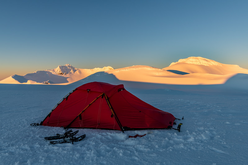 Campsite on Mount Ruapehu's Summit Plateau. Tahurangi and Paretetaitonga are in the background; Glacier Dome at centre image.