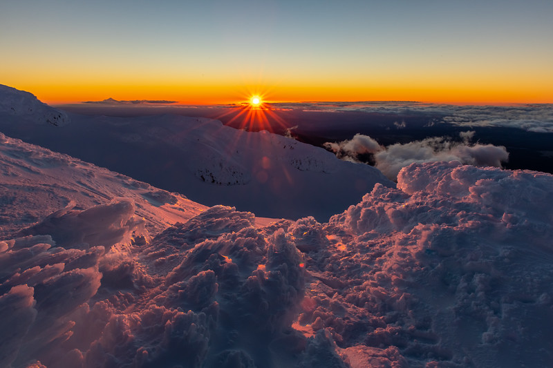 Sunset on Mount Ruapehu's crater rim. Taranaki is back left.