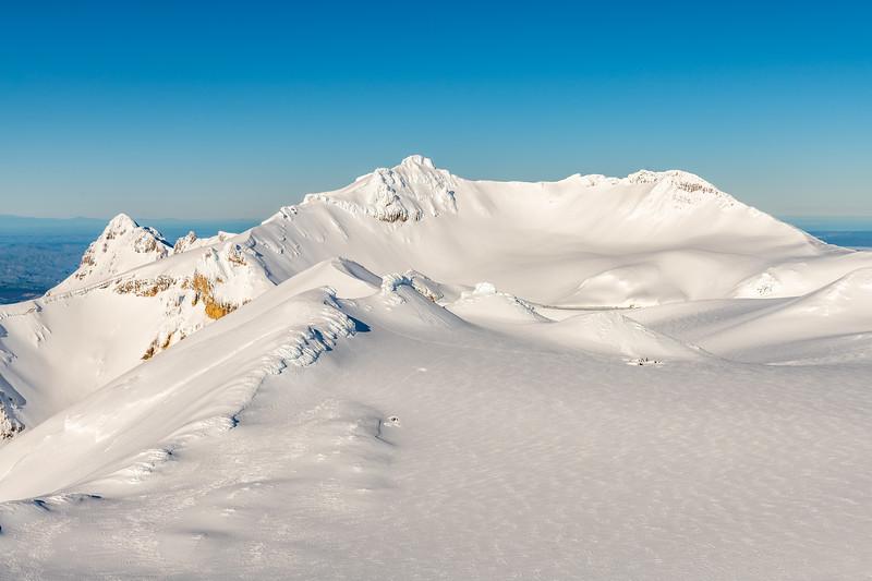 Looking down onto Mount Ruapehu's Summit Plateau from Tukino Peak. Girdlestone Peak and Tahurangi are in the background.