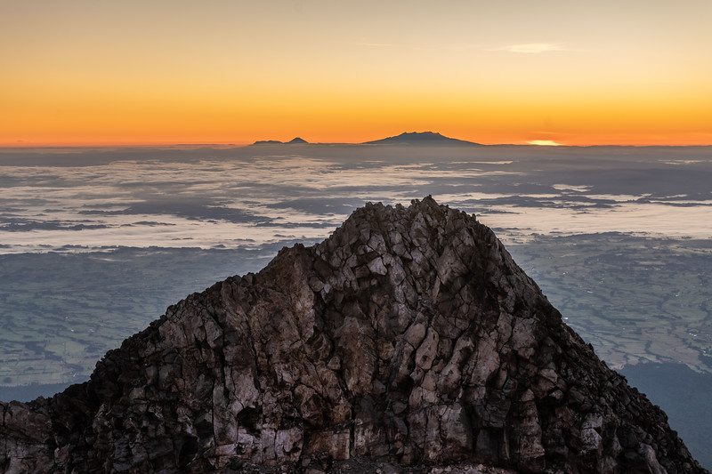 Sharks Tooth (front), Ngauruhoe and Ruapehu (back) from the summit of Taranaki at dawn.