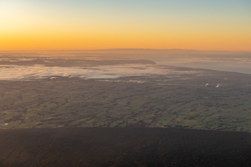 View south-east from Taranaki at sunrise. The mountains of the South Island are on the skyline.