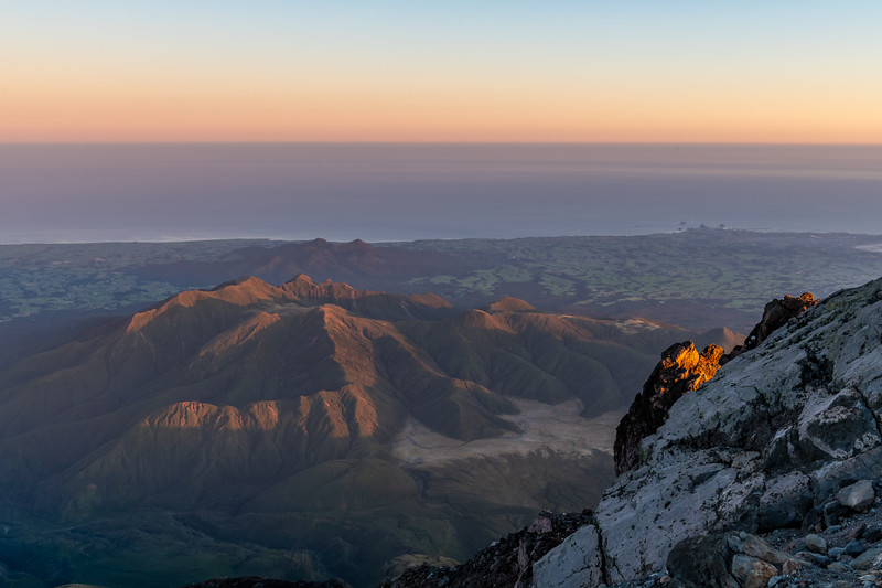 Looking north-west from Taranaki over the Pouakai Range and the Kaitake Range. New Plymouth back right.