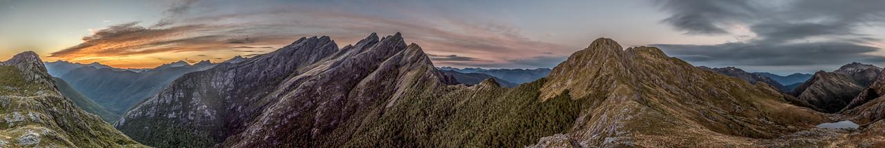 Dawn panorama from the ridge south of Adelaide Tarn: Mount Snowdon, Drunken Sailors, Anatoki Peak, Dragons Teeth, Mt Douglas, Trident, Adelaide Tarn and the Lead Hills.