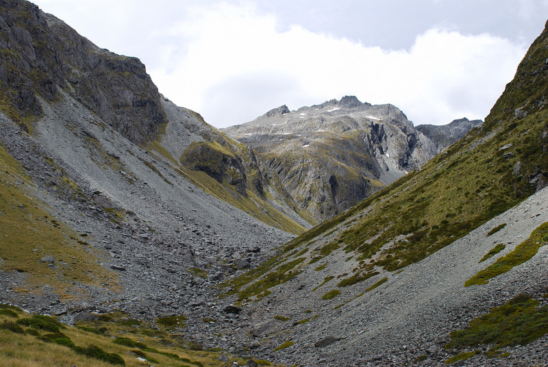 East Matakitaki valley head. The obvious scree ramp through the bluffs gives access to D'Urville Pass.