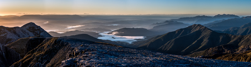 Panorama from the summit of Mount Arthur at sunrise. The tops of the Inland Kaikoura Range are on the far left; Mount Owen is on the far right.