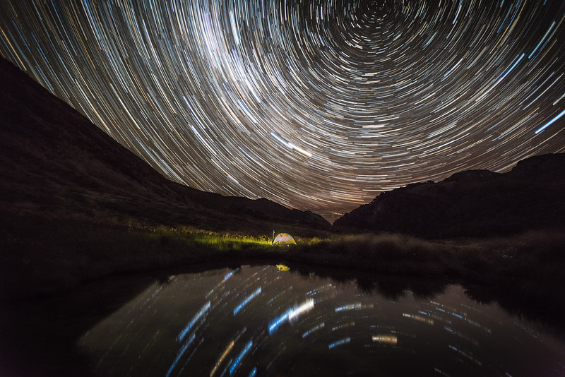 Star trails over campsite in Ellis Basin