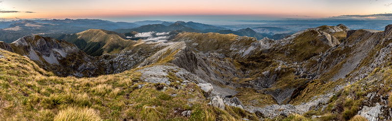 Panorama from the summit of Mount Arthur. The karst landscape of Horseshoe Basin is in the foreground. Tasman Bay is visible in the distance.