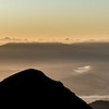 The Inland Kaikoura Range at sunrise from the summit of Mount Arthur. Mount Tapuae-O-Uenuku and Mount Alarm are the two highest peaks on the left.