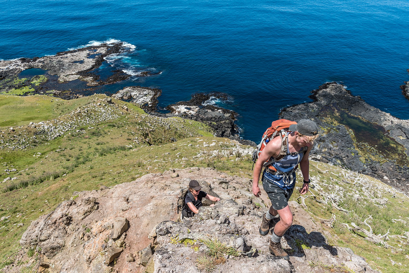 Scrambling up the rocky spur above Green Point, Chatham Island.