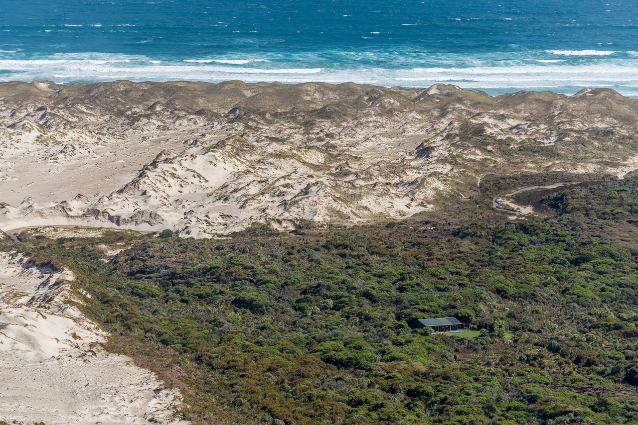 Mason Bay Hut from the top of Big Sandhill