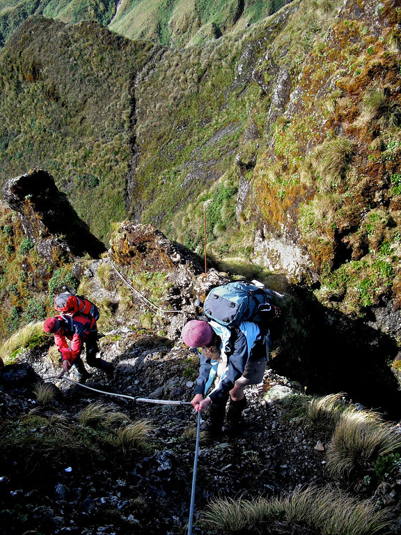 Jane and Dave descend a gully between the peaks
