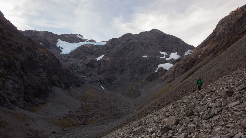 Almost at the bottom of the scree, Crow Face at the head of the valley.