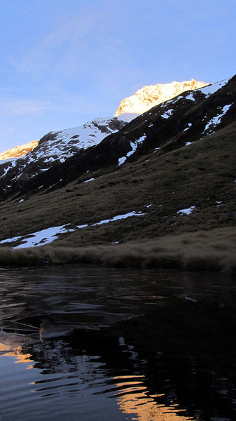 Frozen tarn near Taruahuna Pass.