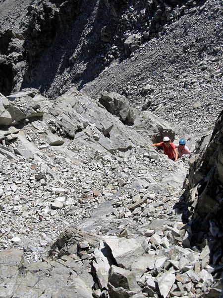 Ascending a chossy gully on Mt Scott.