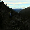 James dropping down the creek draining the swampy clearing above Hunts Saddle.