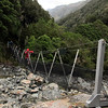 Julia crossing Tumbledown Creek swingbridge.