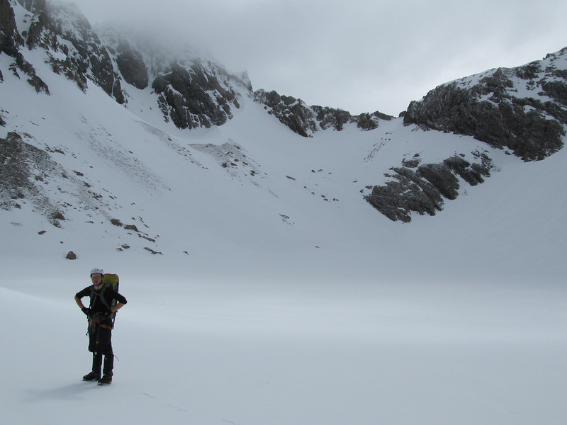 At frozen Lake Anna, the route goes up the snow lead to left of the lowest point on the ridge.