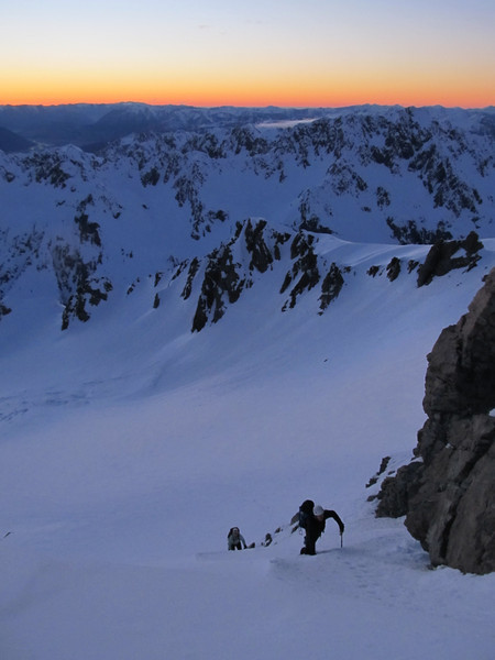 Simon and Lorraine climbing the couloir to gain the North Rige of Murchison, White Glacier below.