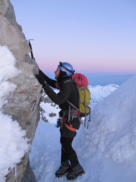 James dry-tooling at the top of the couloir.