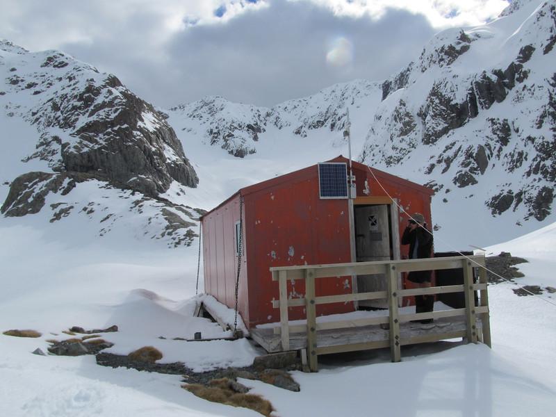Barker Hut with Marmaduke Dixon Glacier behind.
