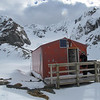 Barker Hut with Marmaduke Dixon Glacier behind.