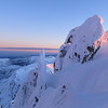 Admiring the colours on the snow, looking along the ridge at sunrise.