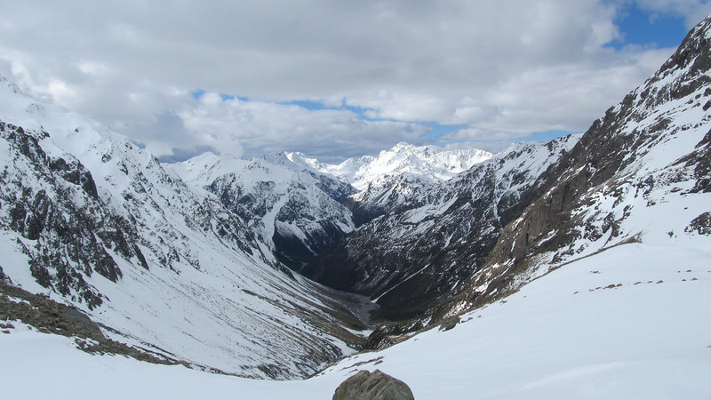View down the White River from Barker Hut, Rolleston in the distance (right off centre), Waimak Col on the left of it.