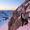 Lorraine at the top of the couloir at sunrise.