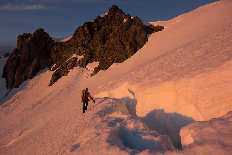 Negotiating a crevasse below the summit of Davie.