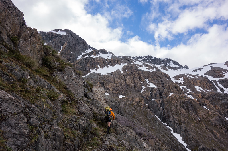 Sidling through bluffs above the gully.