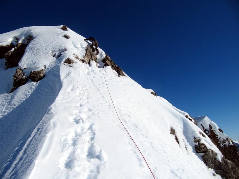 Me climbing a step on the summit ridge (photo - James Thornton).