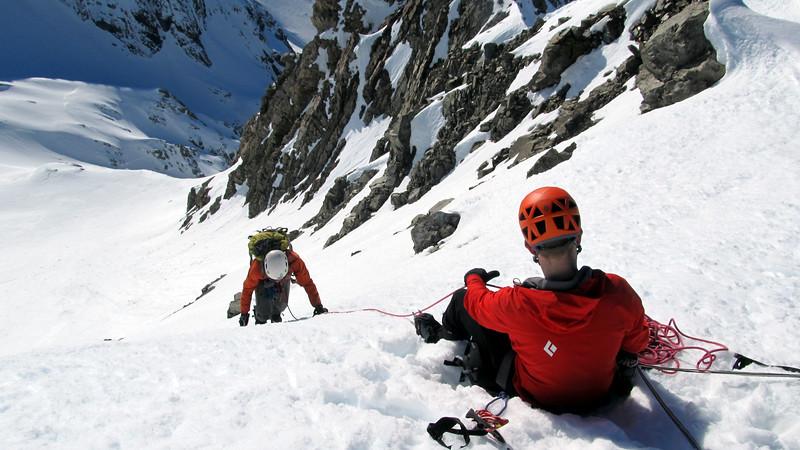 Dave belaying James up to the summit ridge.
