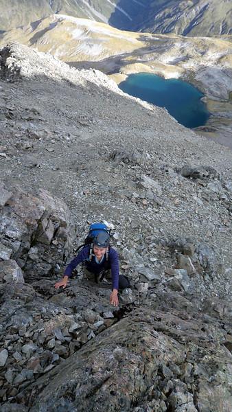 Me climbing to the West Ridge of Oates, Lake Mavis below (photo James Thornton).