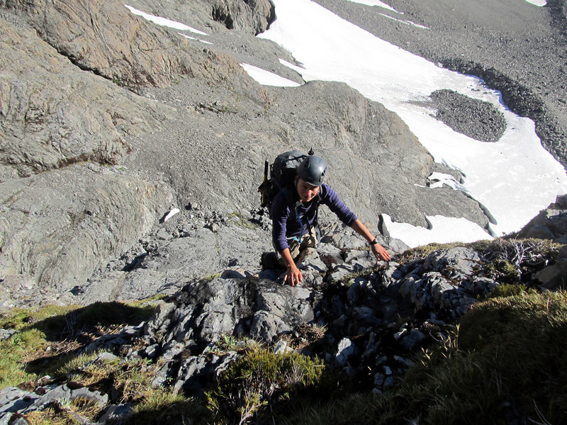 Climbing the green bluffs to get to the bottom of the buttress.