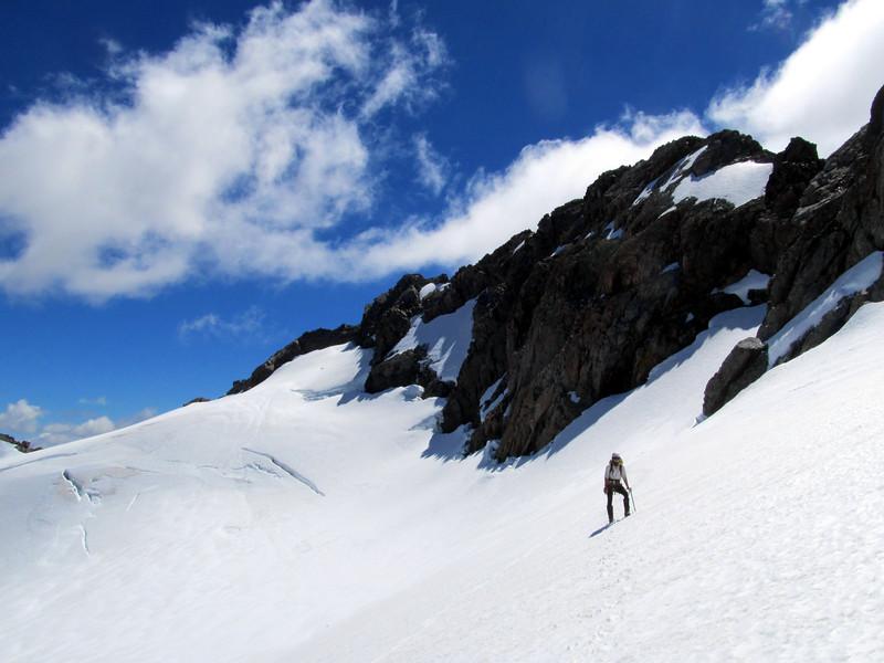 Plod across the Crow Glacier to the Low Peak.