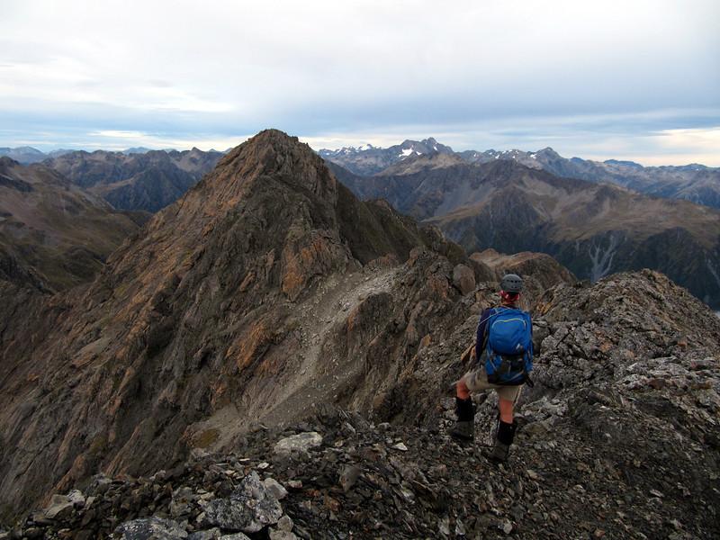 On the exposed NE ridge of Mt Russel leading to the summit. Mt Rolleston left of the summit.