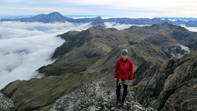 Me on the summit with the ridge we traversed below.