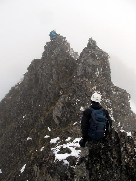 Coming back along the ridge, Marta climbing over a gendarme.