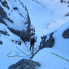 Andrew abseiling down the gully off the Phipps-Temple col.
