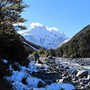 Walking up the Waimak past the White confluence, with Carrington Peak above.