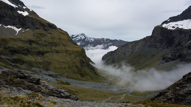 View into Pearson Stream from Pearson Saddle. The route into the Waiatoto sidles above bluffs on the left to the prominent shoulder across the valley.